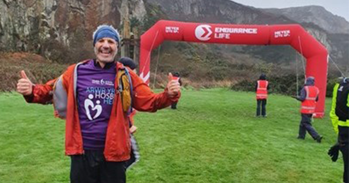 Rhos on Sea man conquers the Holyhead half in stormy conditions and raises hundreds for local hospice